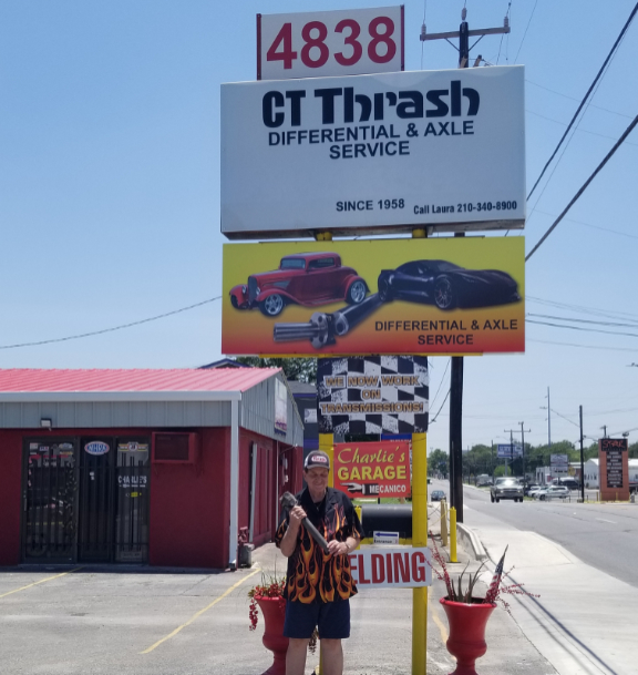 July 19, 2018: Photo of Charlie Thrash, standing in front of his shop at 4838 West Ave, San Antonio, TX, holding a driveshaft he's just re-built